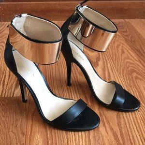 Bebe black leather heels w/ Gold ankle cuffs sz 7